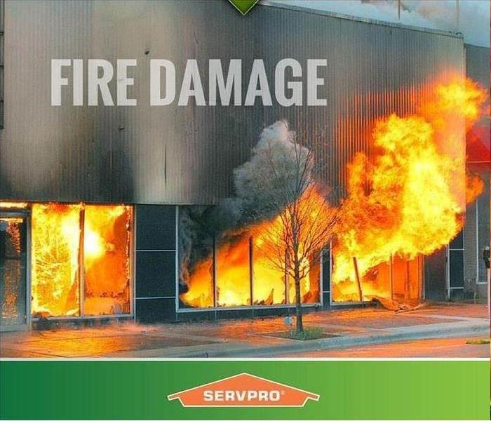 building with fire coming out of the windows and a SERVPRO border