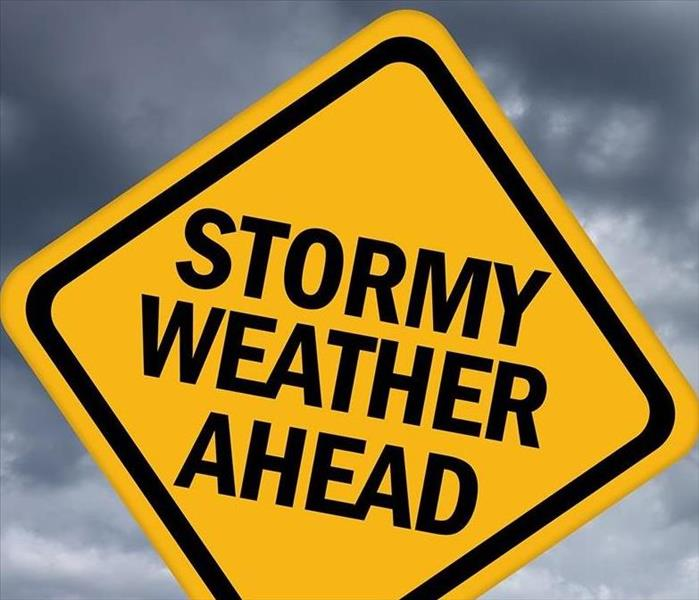 yellow road sign that says stormy weather ahead