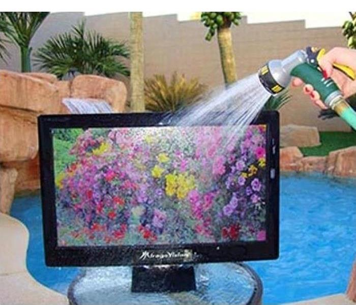 Water spraying on monitor